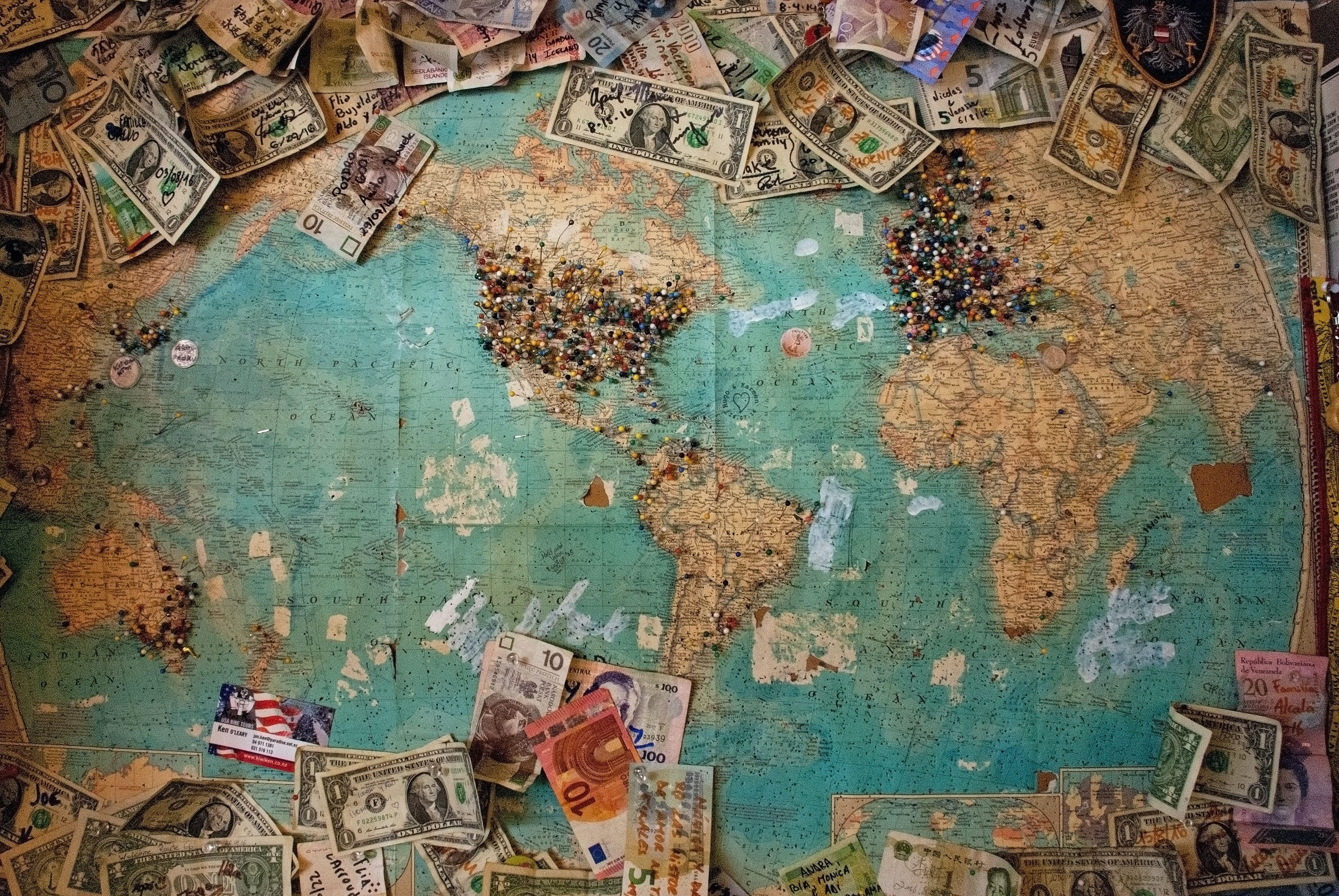 Map with money on it. Earn money through your digital marketing agency anywhere on the globe.